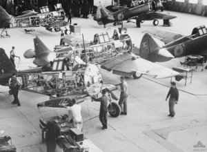Workers move a Wirraway along the assembly line in 1940